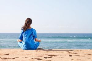 nurse-meditating-on-the-beach